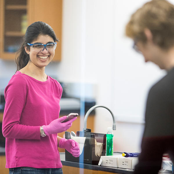 student with safety glasses in a lab