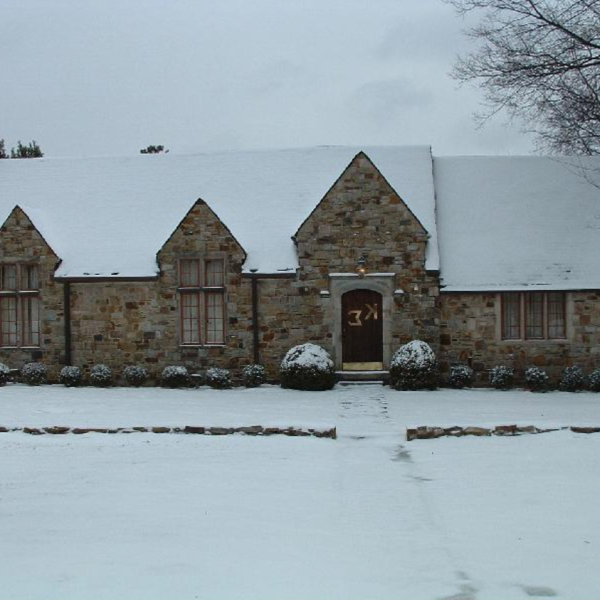 A stone house in the snow