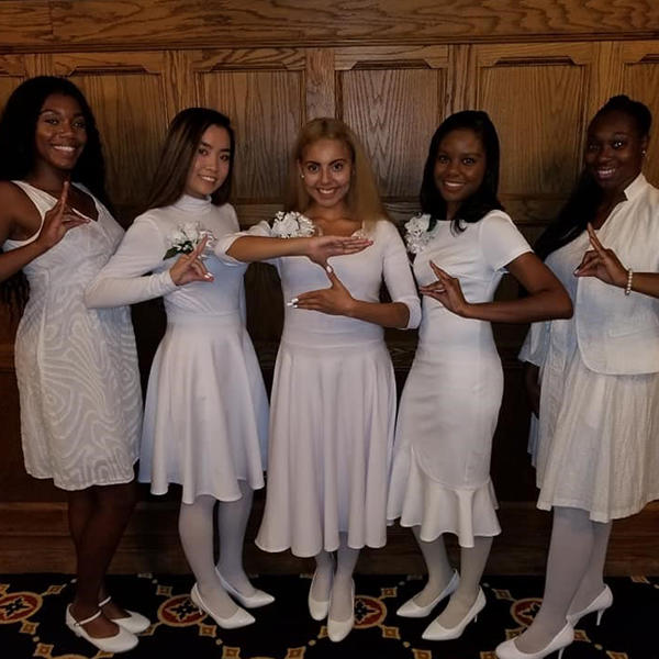 five African American women in white dresses