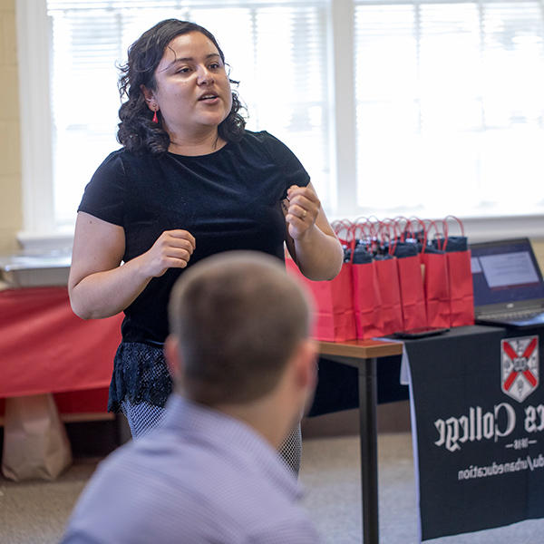 A  Latina student speaking at  orientation for the master's program