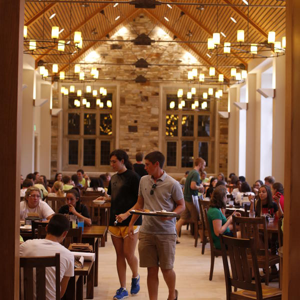 students in a large dining hall