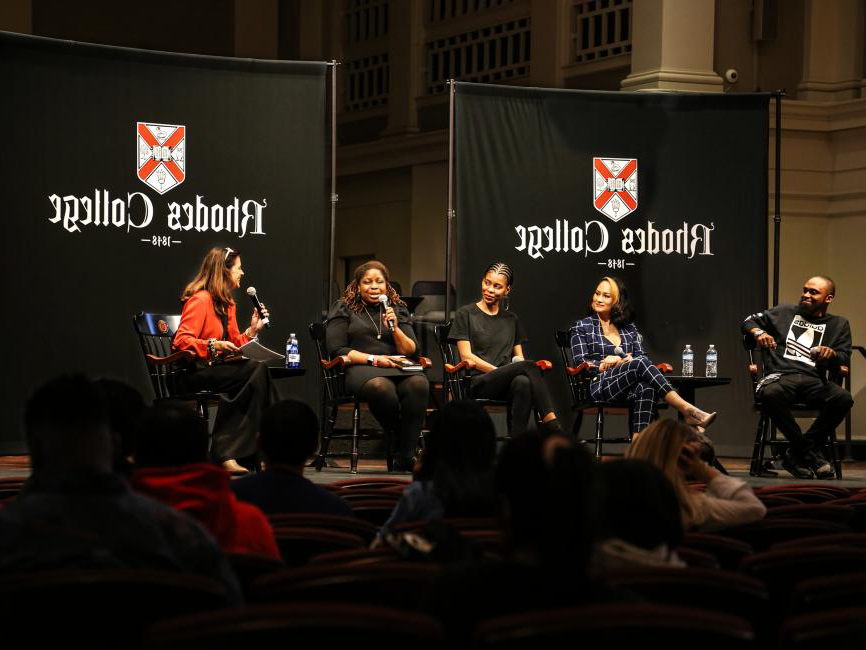 five panelists seated on a stage