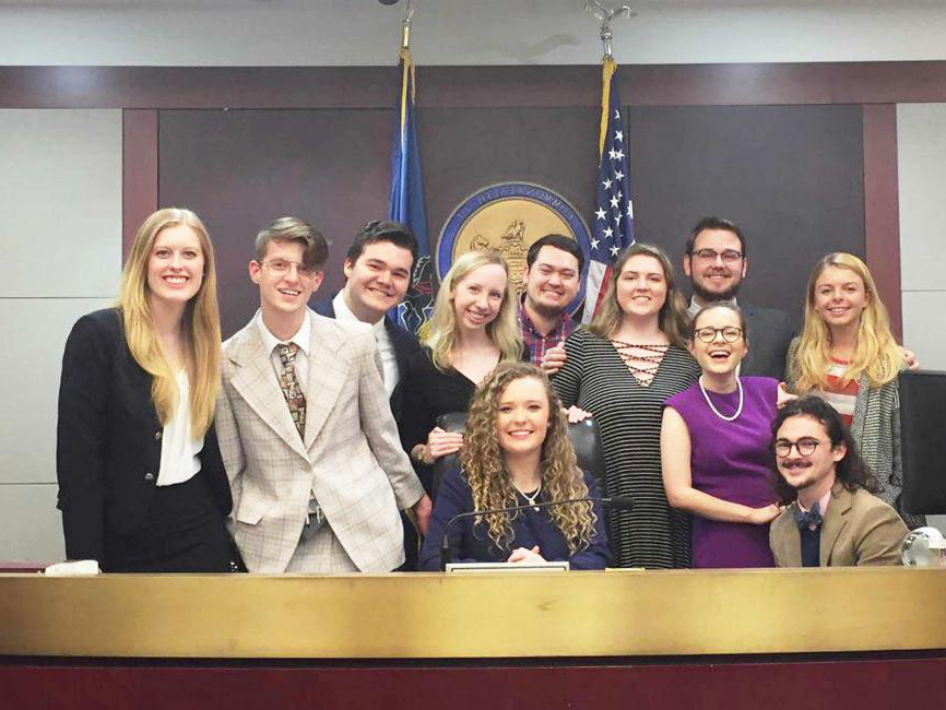 group of students posing in a courtroom setting