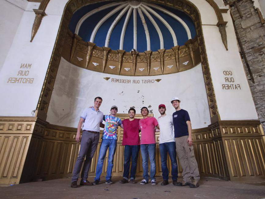a group of students standing in a Jewish Temple